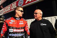Feb. 27, 2011; Pomona, CA, USA; NHRA funny car driver Bob Tasca III (left) with Gary Densham during the Winternationals at Auto Club Raceway at Pomona. Mandatory Credit: Mark J. Rebilas-.