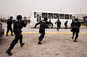 Mexico City, Mexico<br /> June 17, 2008<br /> <br /> A SWAP team of Federal Police practice maneuvers at the new federal police center.