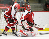 Jared Keller (St. Lawrence - 21), David Grilk (St. Lawrence - 33) - The Harvard University Crimson defeated the St. Lawrence University Saints 4-3 on senior night Saturday, February 26, 2011, at Bright Hockey Center in Cambridge, Massachusetts.