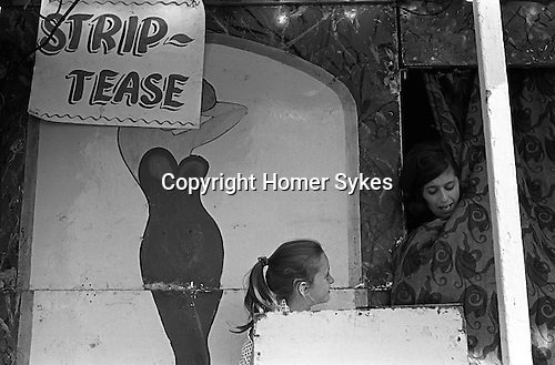 Strip tease booth at the Derby Horse Race Epsom Downs. Surrey England 1969