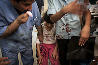 Syrian children arrive at the hospital to get medical treatment after being injured by aircraft shelling carried out by Assad'a army over a residential neighborhood of Aleppo City. The Hospital located at the northeast area of the City was targeted four times by aircraft shelling, depite the bombing the Hospital still operating and giving medical care to the civilian population.