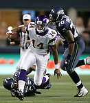 Minnesota Vikings quarterback Joe Webb scrambles away from Seattle Seahawks Malcolm Smith (53) at CenturyLink Field in Seattle, Washington August 20, 2011. The Vikings beat the Seahawks  20-7. ©2011 Jim Bryant Photo. All Rights Reserved.