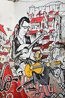 Detail of the Fado Vadio graffiti mural in the Escadinhas de Sao Cristovao, Alfama, Lisbon, Portugal. The mural celebrates traditional fado folk music, which originated from here. It was created by the Movimento dos Amigos de Sao Cristovao, a local community group, which worked with artists to create the graffiti mural. The work contains portraits of fado singers such as Maria Severa and Fernando Mauricio, song lyrics and views of the neighbourhood. Picture by Manuel Cohen