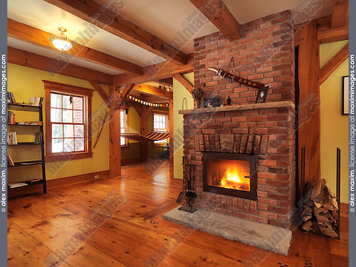 Burning fireplace in a timberframe Canadian country house living room interior , Muskoka, Ontario, Canada