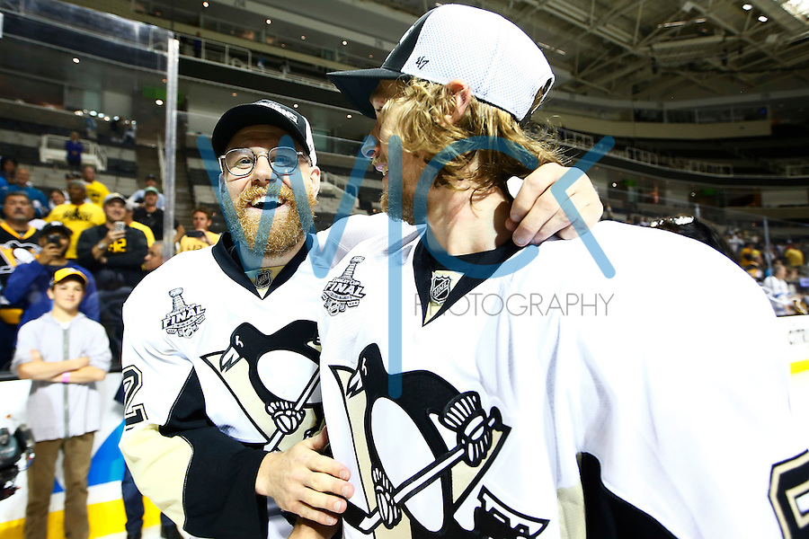 Patric Hornqvist #72 wears a pair of glasses for Carl Hagelin #62 of the Pittsburgh Penguins following their 3-1 win against the San Jose Sharks during game six of the Stanley Cup Final at SAP Center in San Jose, California on June 12, 2016. (Photo by Jared Wickerham / DKPS)