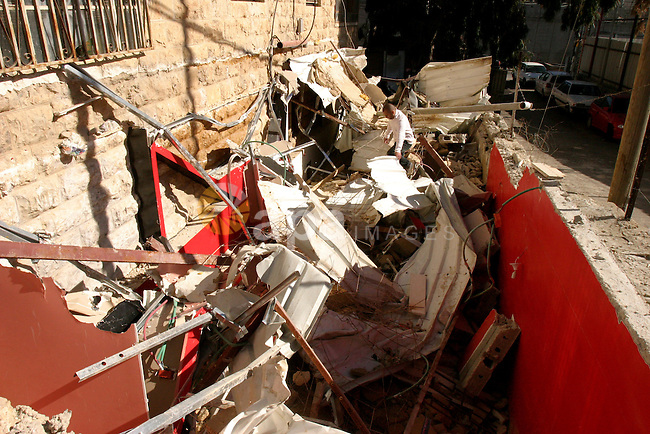 A Palestinians inspect the rubble of their house follow an Israeli bulldozer demolished it that was built without a construction permit, in the Arab Jerusalem city on Dec. 12, 2011. Photo by Mahfouz Abu Turk