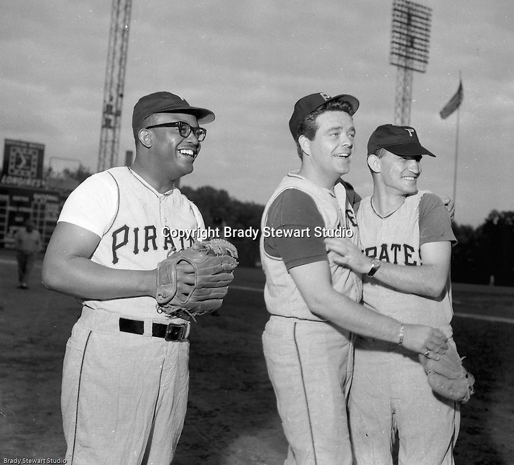Pittsburgh PA:  View of local TV personalities during the 1966 HYPO (help young players organize) Game between the Pittsburgh Pirates and Milwaukee Braves.  Celebrities include: I believe it's Bill Powell of WAMO (left), Clark Race KDKA Radio and TV (center) and no idea person on the right.<br /> <br /> Before the game, the Pirate Old Timers played a few innings against local TV and Radio personalities.