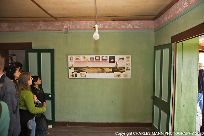 Visitors to the Trinity Atomic Bomb Test Site examine a panoramic photo of the Mc Donald cabin while standing in the bedroom where the atomic test bomb was assembled during the famous trials in 1944 near Socorro, NM.