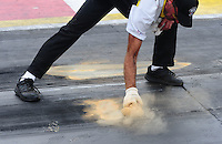 April 30, 2011; Baytown, TX, USA: NHRA safety safari putting down rosin on starting line during the Spring Nationals at Royal Purple Raceway. Mandatory Credit: Mark J. Rebilas-