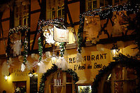 Traditional festive  restaurant at night with christmas  decorations - Strasbourg, Alsace France