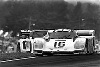 """LEXINGTON, OH - JUNE 9: The Dyson Racing Porsche 962 101 driven by Drake Olsen and Rob Dyson lifts a wheel in the """"Keyhole"""" corner during the Lumbermens 500k IMSA GTP/Lights race at the Mid-Ohio Sports Car Course near Lexington, Ohio, on June 9, 1985."""