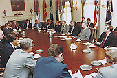 United States President Jimmy Carter meets with US Senate and US House leadership in the Cabinet Room of the White House in Washington, DC on April 25, 1980 to discuss the to discuss the unsuccessful attempt to rescue the US Embassy personnel held hostage in the US Embassy in Tehran, Iran.  Those attending the meeting include, from right to left: US Senate Minority Leader Howard H. Baker, Jr (Republican of Tennessee); US Senate Majority Leader Robert C. Byrd (Democrat of West Virginia); President Carter; US House Majority Leader James C. Wright, Jr. (Democrat of Texas); US House Minority Leader John J. Rhodes, Jr. (Republican of Arizona); and US Vice President Walter Mondale.  Also recognizable is US Senator Claiborne Pell (Democrat of Rhode Island) at left in the brown suit.<br /> Mandatory Credit: Bill Fitz-Patrick - White House via CNP