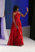 United States first lady Michelle Obama arrives for the Commander-In-Chief Ball at the Walter Washington Convention Center January 21, 2013 in Washington, DC. President Barack Obama started his second term by taking the Oath of Office earlier in the day during a ceremony on the West Front of the U.S. Capitol. .Credit: Chip Somodevilla / Pool via CNP