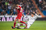 """Raphael Varane (r) of Real Madrid competes for the ball with Victor Machin Perez """"Vitolo"""" of Sevilla FC in action during their Copa del Rey Round of 16 match between Real Madrid and Sevilla FC at the Santiago Bernabeu Stadium on 04 January 2017 in Madrid, Spain. Photo by Diego Gonzalez Souto / Power Sport Images"""