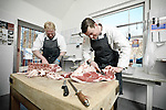 Scott Bailey and Rich Summers preparing meat at F Bailey and Sons butchers, Upper Broughton, Near Melton Mowbray, Leicestershire