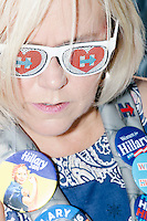 "Camilla Millican-Samuelson, of Delray Beach, Florida, wears pro-Clinton sunglasses and campaign buttons while waiting to enter a campaign rally for Democratic presidential nominee Hillary Clinton in the Theodore R. Gibson Health Center at Miami Dade College-Kendall Campus in Miami, Florida, USA. Former Vice President Al Gore also spoke at the rally. ""I especially like the work that she's done with children and for children,"" she said. ""She's gonna really work hard for equal rights and equal pay. If you get pregnant you won't lose your job."" Asked about the prospect of having the first woman president, she said, ""I could cry. I think it's important for everyone in this country to see what they can achieve."""