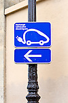 Sign indicating location for recharging electric car on a street in Paris, France
