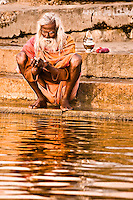 The water of the Ganges is considered sacred and is believed by the devout to be a god. (Photo by Matt Considine - Images of Asia Collection)