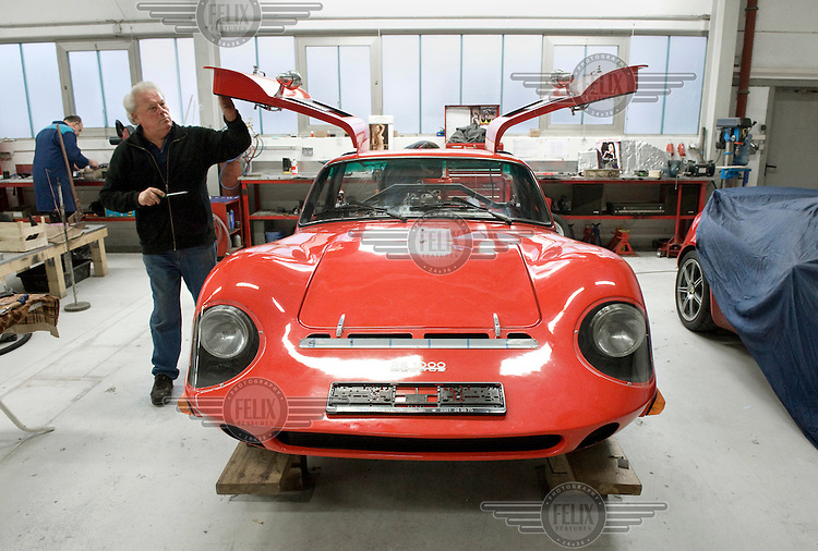 Factory worker assembles a Melkus RS1000 sportscar at the family owned Melkus car factory in Dresden.