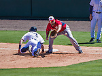 14 March 2014: Washington Nationals first baseman Brock Peterson reaches for a pick-off at first base during a Spring Training game against the Detroit Tigers at Joker Marchant Stadium in Lakeland, Florida. The Tigers defeated the Nationals 12-6 in Grapefruit League play. Mandatory Credit: Ed Wolfstein Photo *** RAW (NEF) Image File Available ***