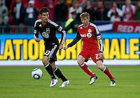 16 April 2011: D.C. United midfielder/forward Chris Pontius #13 and Toronto FC midfielder Jacob Peterson #23 in action during an MLS game between D.C. United and the Toronto FC at BMO Field in Toronto, Ontario Canada..D.C. United won 3-0.
