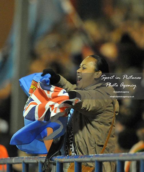 A Fiji fan celebrates waving her flag  - PHOTO: Mandatory by-line: Garry Bowden/SIPPA/Pinnacle - Photo Agency UK Tel: +44(0)1363 881025 - Mobile:0797 1270 681 - VAT Reg No: 768 6958 48 - 28/10/2013 - Rugby League World Cup 2013, Fiji v Ireland, Spotland Stadium, Rochdale, England