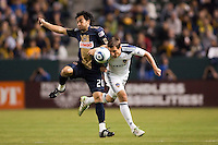 Carlos Ruiz (20) of the Philadelphia Union and Todd Dunivant (2) of the LA Galaxy battle. The LA Galaxy defeated the Philadelphia Union 1-0 at Home Depot Center stadium in Carson, California on  April  2, 2011....