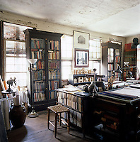 Randolph Martz's draughting room houses some of his vast collection of 12,000 books