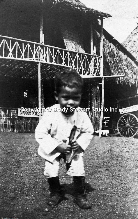 St Louis MO:  A view of a boy dancing for money in the Philippine Village.  The Philippine Village was one of the most popular attractions at the Louisiana Purchase Exposition