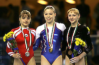 (L-R) Anna Pavlova of Russia (2nd), Marine Debauve of France (1st), and Yulia Lozhecko of Russia (3rd) are All-Around winners in women's artistics gymnastics at European Championships in Debrecen, Hungary, June 4th. Photo by Tom Theobald