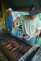 Mountain View, Alberta, Canada, July 2008. Cowboy Calin Duce cooks steaks for dinner. Rancher Dan Nelson takes us on a horse back trail ride in the hills connecting the Albertan prairie with the mountains of Waterton National Park. Photo by Frits Meyst/Adventure4ever.com