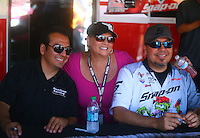 Jul. 26, 2014; Sonoma, CA, USA; NHRA funny car drivers Tony Pedregon (left) and Cruz Pedregon (right) pose with a fan during qualifying for the Sonoma Nationals at Sonoma Raceway. Mandatory Credit: Mark J. Rebilas-