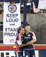 New England Revolution midfielder Kelyn Rowe (11) celebrates his goal with New England Revolution substitute midfielder Ryan Guy (13). In a Major League Soccer (MLS) match, the New England Revolution (blue) defeated Chicago Fire (red), 2-0, at Gillette Stadium on August 17, 2013.