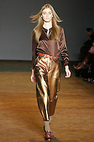 Kori Richardson walks runway in a duke brown disco satin blouse, partridge limelight metallic leather pants, and dark brown and brick lace up oxfords, from the Marc by Marc Jacobs Fall/Winter 2011 collection, during New York Fashion Week, Fall 2011.