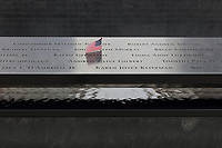 Names of victims of the 9/11 terrorist attacks inscribed around the South Tower pool of the National September 11 Memorial & Museum, designed by Davis Brody Bond, Michael Arad and Peter Walker, on the site of the original Twin Towers World Trade Center buildings which were destroyed in the terrorist attack of 11th September 2001, Manhattan, New York, New York, USA. The memorial and museum commemorate the 9/11 attacks, which killed 2,977, and the World Trade Center bombing of 1993, which killed 6. The memorial forms part of the new World Trade Center complex, which includes 5 skyscrapers and the museum. The memorial consists of 2 enormous reflecting pools and waterfalls within the footprint of the Twin Towers, surrounded by trees. Picture by Manuel Cohen