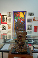 """Coyoacan, Mexico City - The Leon Trotsky House Museum is a venue honoring Leon Trotsky's life.  The venue displays memorabilia such as photographs, newspapers and Trotsky personal effects.  The site also houses an organization that works to promote political asylum.  The museum is a favorite destination of millions of tourists every year, and it is located in the Coyoacan borough of Mexico City.  The museum was built next to the house in which Trotsky lived with his second wife Natalia Sedova from 1939 to 1940, and where the Russian dissident was also murdered and buried.  The house has been preserved as it was at that time where Trotsky lived there, in particular the study in which Joseph Stalin' supporter Ramon Mercader killed Trotsky with an ice axe to the back of the head.  Around the house is a garden and high walls with watchtowers.  The complex was turned into the current museum and asylum institution in 1990, on the 50th anniversary of the assassination.  Coyoacan's name comes from Nahuatl it likely meaning """"place of coyotes"""".  Hernán Cortes and the Spanish conquistadors used this area as a headquarters during the Spanish conquest of the Aztec Empire. They also made it the first capital of New Spain between 1521 and 1523.  In recent times, has been a counterculture hotbed and where Frida Kahlo and Diego Rivera lived, a few blocks away from Leon Trotsky.  Due the historic and cultural relevance, their homes are now the Frida Kahlo Museum and the Leon Trotsky Museum, which are visited by thousands of tourists every year.  Modern-day Coyoacan is a quiet residential area with cobblestone streets, restaurants, parks, squares, and a favorite hangout for bohemia enthusiasts. Photo by Eduardo Barraza © Copyright"""