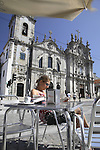 Woman reading on cafe terrace outside Carmo (Carmen) Church, Porto - Oporto, Douro Litoral, Portugal