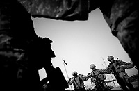 U.S. soldiers pray before leaving their camp for a mission in Baghdad August 5, 2007.