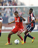 Toronto FC forward Ryan Johnson (9) controls the ball as New England Revolution midfielder Clyde Simms (19) defends. In a Major League Soccer (MLS) match, Toronto FC defeated New England Revolution, 1-0, at Gillette Stadium on July 14, 2012.
