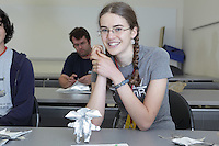 New York, NY, USA - June 26, 2011: Jenny Ramseyer, Origami folder, with a complex mouse model designed by Mike Assis which she has folded in a class at the OrigamiUSA Convention in New York City.