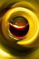 """Beauty at the Bottom: Red Wine 7"" - This is a photograph of a red wine bottle bottle, shot right down inside the mouth of the bottle."