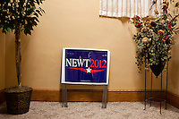 Yard signs for Republican presidential candidate Newt Gingrich are available to guests at a meet and greet at Swamp Fox Restaurant on Tuesday, December 20, 2011 in Knoxville, IA.