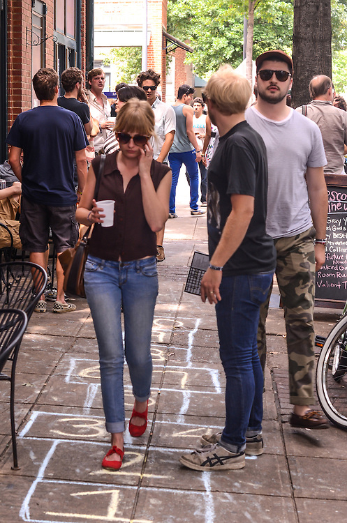 Musicians and festival goers gathered on Blount Street during Hopscotch Music Festival, Raleigh, NC. September 7, 2012.