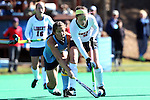 15 November 2014: Liberty's Serena Barr (NIR) (9) and North Carolina's Samantha Travers (ZIM) (left). The University of North Carolina Tar Heels hosted the Liberty University Flames at Francis E. Henry Stadium in Chapel Hill, North Carolina in a 2014 NCAA Division I Field Hockey Tournament First Round game. UNC won the game 2-1.