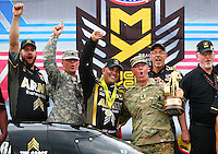 Sep 5, 2016; Clermont, IN, USA; NHRA top fuel driver Tony Schumacher celebrates with crew after winning the US Nationals at Lucas Oil Raceway. Mandatory Credit: Mark J. Rebilas-USA TODAY Sports
