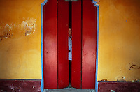 Nguyen Van Nam, 25, a Buddhist volunteer at the pagoda, locks up the doors after prayer time at the Giac Vietn Pagoda in District 11 in Ho Chi Minh City, Vietnam. Photo taken Monday, May 3, 2010..Kevin German / LUCEO
