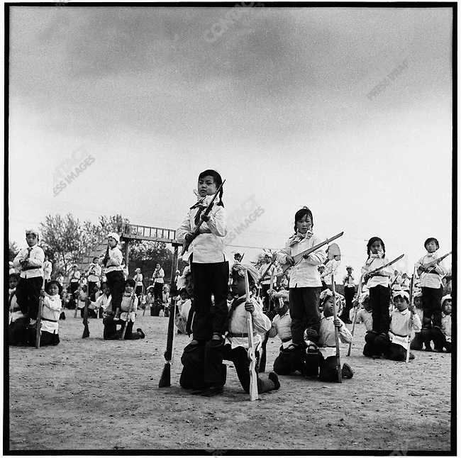"""As part of the national defense against """"imperialism abroad and revisionists at home,"""" school-children of the """"Little Red Militia"""" and workers from an electrical-component factory participate in militia drills.  Acheng county, 30 May 1965"""