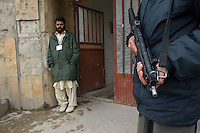 Russian Cultural Palace Kabul. The building was destroyed by the Mujahadeen during the Afghan civil war. Hundreds of people use the building to smoke and inject heroin. The Welfare Association for the Development of Afghanistan (WADAN) has reclaimed part of the building and turned it into a rehabilitation clinic. An armed Policeman stands guard at the entrance to the rehab clinic.