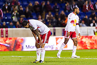 Tim Cahill (17) and Thierry Henry (14) of the New York Red Bulls react to a missed scoring opportunity. D. C. United defeated the New York Red Bulls 1-0 (2-1 in aggregate) during the second leg of the MLS Eastern Conference Semifinals at Red Bull Arena in Harrison, NJ, on November 8, 2012.
