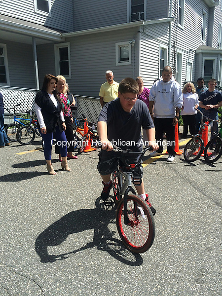 TORRINGTON, CT- 05 June 2015-060515CH3 -- A FISH resdident takes his first ride on a bicycle donated by the LARC Transition class.  Carrie Grace Henderson Republican-American